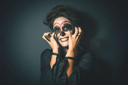 devil girl: Portrait of woman in disguise for Halloween Stock Photo