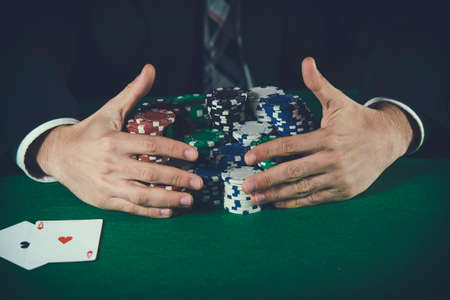 betting: Man betting on the casino Stock Photo