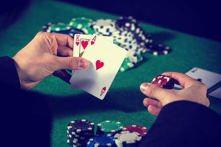 holdem: Man in casino with couple of ace and king