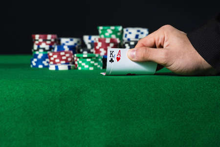 double the chances: Closeup of poker player with two aces