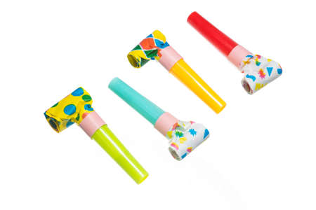Party blowers on white background