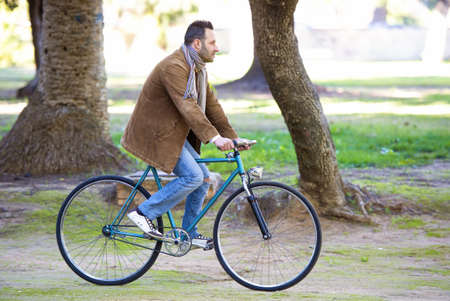 middle age man: Man riding in bike for the park Stock Photo
