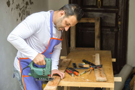home repairs: Middle aged man doing home repairs Stock Photo
