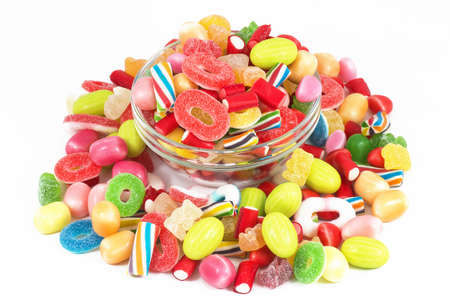 Glass jar full of candies isolated in white background