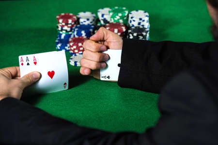 sleeve: Man with ace up his sleeve, cheating at poker. Stock Photo