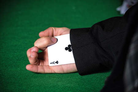 sleeve: Man with ace up his sleeve. Stock Photo
