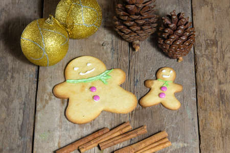 festive pine cones: Cookies and Christmas decorations on wooden table