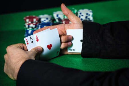 his: Man with ace up his sleeve, cheating at poker. Stock Photo