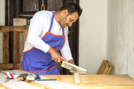 handsaw: Carpenter cutting with handsaw in the carpentry Stock Photo