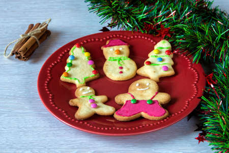 christmas cookies decorated with fondant on table stock photo 48198443
