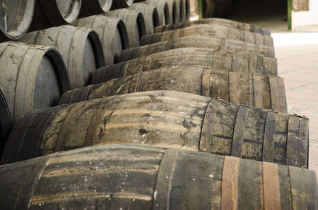 sherry: Barrels for whiskey or wine stacked in outdoor Stock Photo