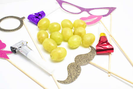 blowers: Twelve grapes and utensils for New Years holiday Stock Photo