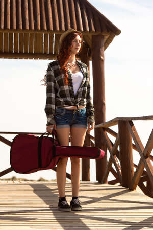 holster: Young woman with guitar stuck in the holster