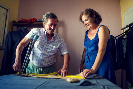 tailoring: Mature couple working together on a tailoring Stock Photo