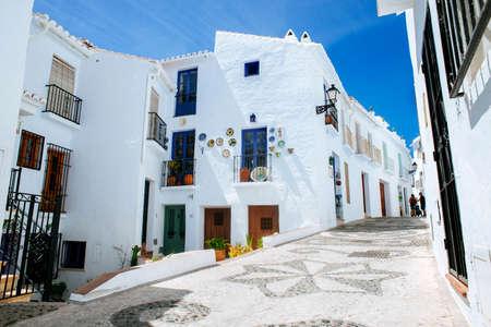 touristic: Typical street in Frigiliana, white town on the Costa del Sol, Malaga, Spain. Stock Photo