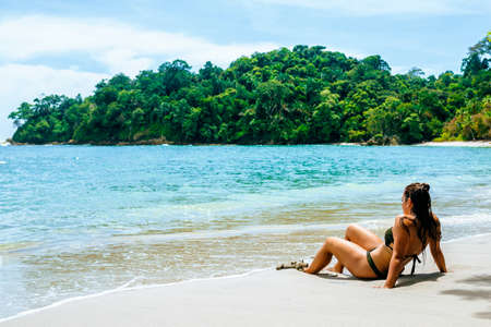 Woman lying on the beach of Manuel Antonio National Park, Costa Rica.