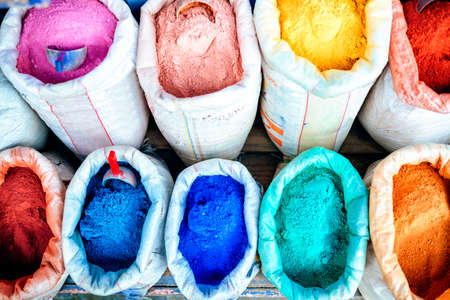 Sacks of wall tint and clothes in stores in Chefchaouen, Morocco.