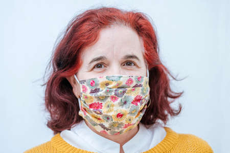 Portrait of mature woman with protective mask Banco de Imagens