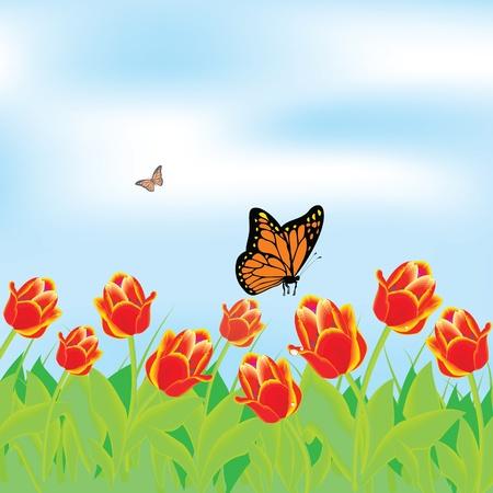 チューリップと春の風景の中に蝶