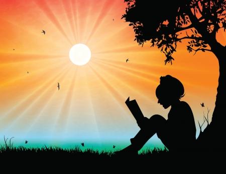 ni�os leyendo: Lectura de la chica joven en el fondo de la puesta del sol