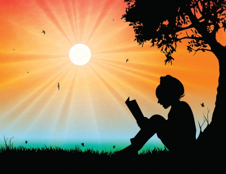 Young girl reading in sunset background