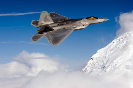 A Boeing F-22A Raptor of the US Air Force flies over Alaska, United States. Editorial