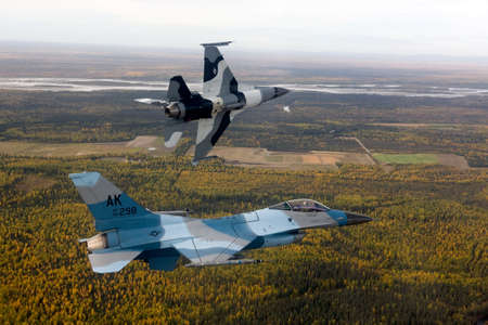 mountin: US Air Force F-16 Vipers fly over Alaksa.