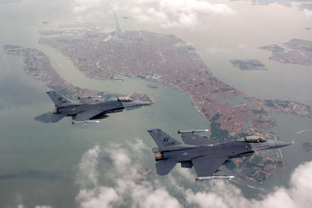 supremacy: US Air Force F-16 Vipers fly over Italy. Editorial