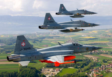 domination: Swiss Air Force F-5E Tiger IIs in formation over the Alps.