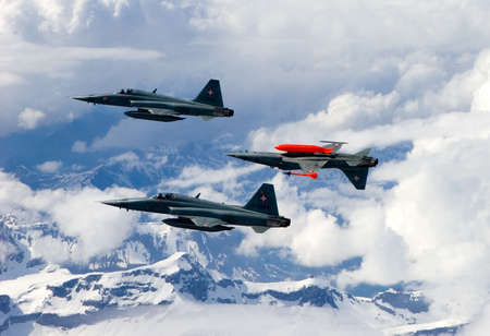 Swiss Air Force F-5E Tiger IIs in formation over the Alps.