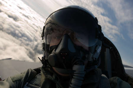 A fighter pilot in his aircraft.