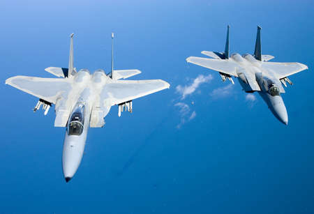 supremacy: US Air Force F-15 Eagles fly over the Gulf Coast of Florida, USA. The Eagles are the Air Forces main air superiority fighter.