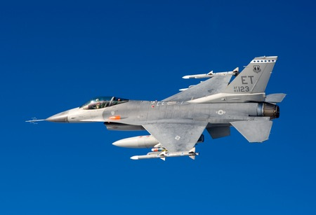 US Air Force F-16 Vipers flies over the Gulf coast of Florida, USA over Italy. The aircraft was testing a new laser-guided bomb known as the GBU-54 Laser joint Direct Attack Munition.