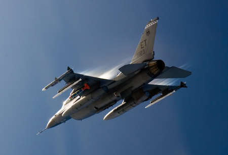 US Air Force F-16 Vipers flies over the Gulf coast of Florida, USA over Italy. The aircraft was testing a new laser-guided bomb,