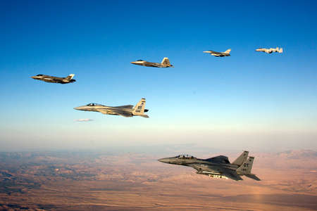 An F-35 Lightning II fighter and other US Air Force jets over NEvada, US.