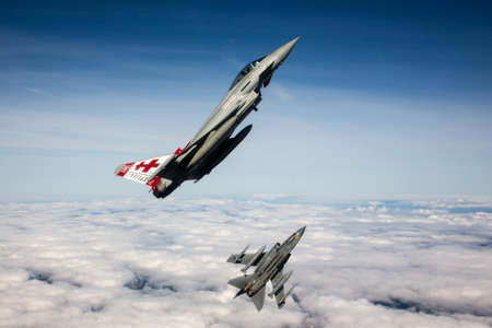 RAF Typhoon and Tornado jet fighters of 41(R)TES, Royal Air Force, over the English countryside.