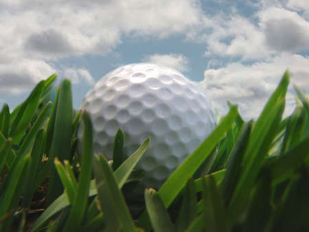 golf ball with clouds Stock Photo
