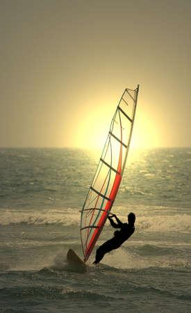 exhilaration: sunset windsurf Stock Photo