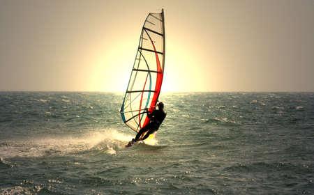 recreate: windsurfer and sunset Stock Photo
