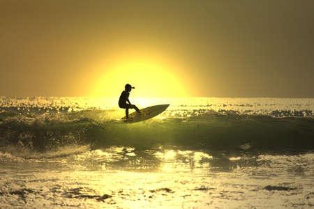 recreate: sunset surf Stock Photo