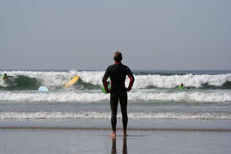 plucky: surf teacher looking the sea Stock Photo