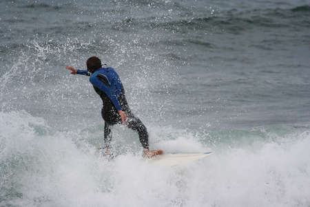 plucky: surfer in the top of the wave Stock Photo