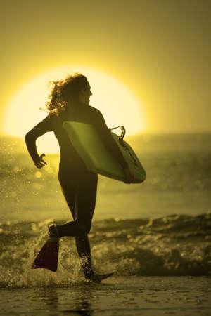 bodyboarder enter in the sea photo