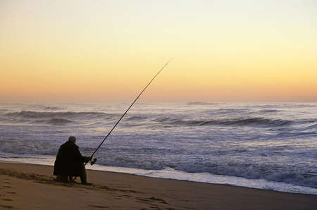 fisherman seated in the beach Stock Photo - 639526