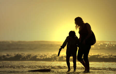 recreate: mother and son with bodyboard board Stock Photo