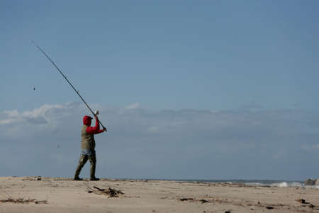 fisherman in the beach with blue sky Stock Photo - 673763