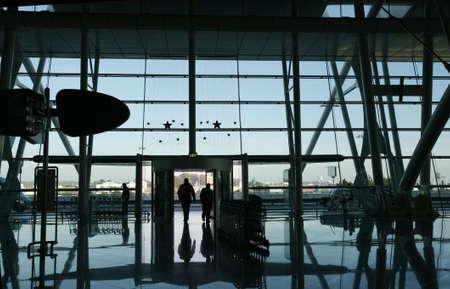 reflex of people at the airport door photo