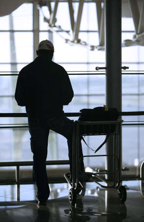 man and trolley at the airport photo