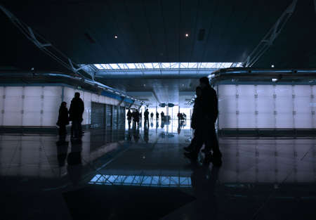 passengers walking by the airport photo