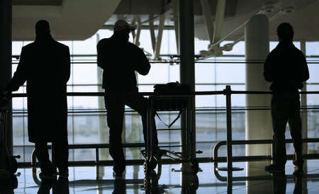 silhouette of people waiting at the airport photo